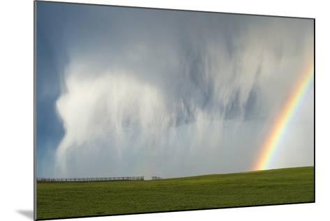 A Thunderstorm Produces a Curtain of Falling Hailstones Next to a Rainbow-Jim Reed-Mounted Photographic Print