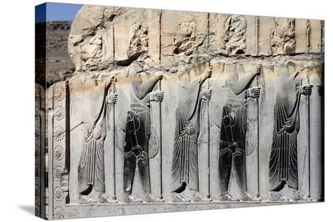Bas-Relief of Persian Guards on a Wall in Persepolis-Babak Tafreshi-Stretched Canvas Print