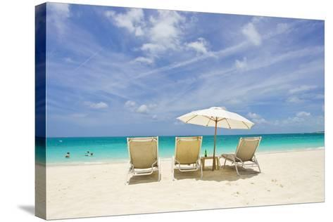 Empty Beach Chairs in the Sand on a Tropical Beach in the Caribbean-Mike Theiss-Stretched Canvas Print