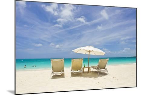 Empty Beach Chairs in the Sand on a Tropical Beach in the Caribbean-Mike Theiss-Mounted Photographic Print