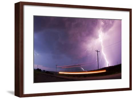 A Large Lightning Bolt Strikes Behind a Storm Chaser's Moving Van-Mike Theiss-Framed Art Print