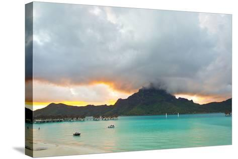 A Cloudy Sunset over Mount Otemanu and the Pacific Ocean-Mike Theiss-Stretched Canvas Print