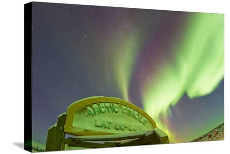 An Aurora Borealis at the Famous Arctic Circle Sign-Mike Theiss-Stretched Canvas Print