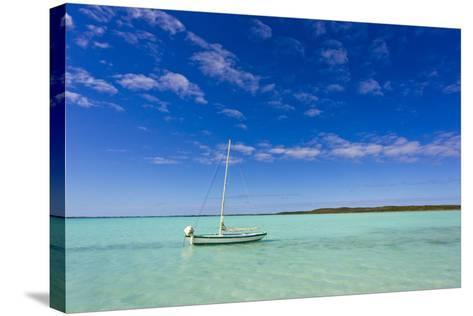 A Lone Sailboat Anchored in Turquoise Water-Mike Theiss-Stretched Canvas Print