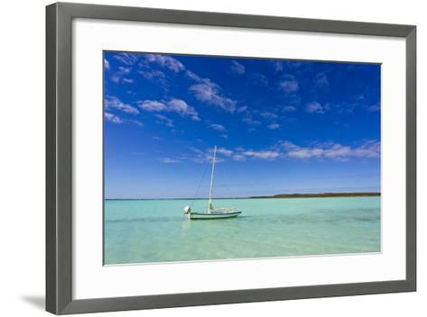 A Lone Sailboat Anchored in Turquoise Water-Mike Theiss-Framed Art Print