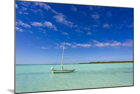 A Lone Sailboat Anchored in Turquoise Water-Mike Theiss-Mounted Photographic Print
