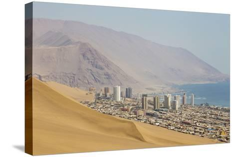 The City of Iquique, Chile, Sprawls Along the Base of Giant Sand Mountains-Mike Theiss-Stretched Canvas Print