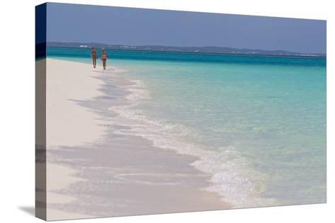 Two People Walking Down the Beach at Grace Bay on the Caribbean Sea-Mike Theiss-Stretched Canvas Print
