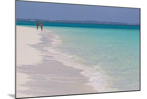 Two People Walking Down the Beach at Grace Bay on the Caribbean Sea-Mike Theiss-Mounted Photographic Print