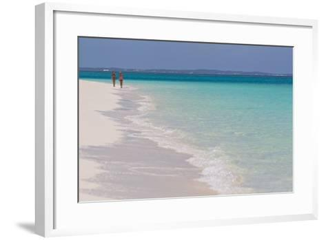 Two People Walking Down the Beach at Grace Bay on the Caribbean Sea-Mike Theiss-Framed Art Print