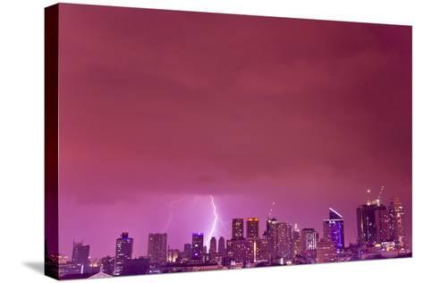 A Intense Thunderstorm with Lightning over the Skyline of Manila-Mike Theiss-Stretched Canvas Print