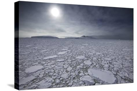 The Sun Shines over Ice Pack in the Grandidier Channel-Jim Richardson-Stretched Canvas Print