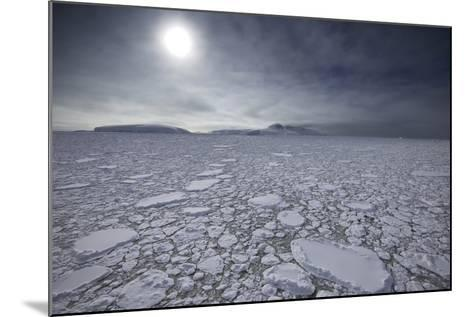 The Sun Shines over Ice Pack in the Grandidier Channel-Jim Richardson-Mounted Photographic Print