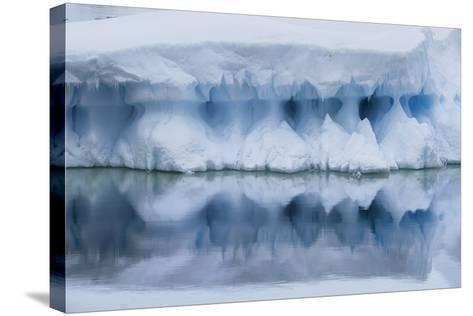 An Iceberg Reflects in the Surface of the Ocean-Jim Richardson-Stretched Canvas Print