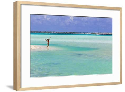 A Woman in a Bikini Posing in the Turquoise Waters at Bora Bora-Mike Theiss-Framed Art Print