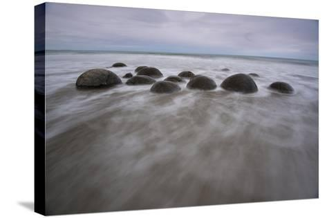 A Long Exposure of the Moeraki Boulders on the South Island Along a Stretch of Koekohe Beach-Michael Melford-Stretched Canvas Print