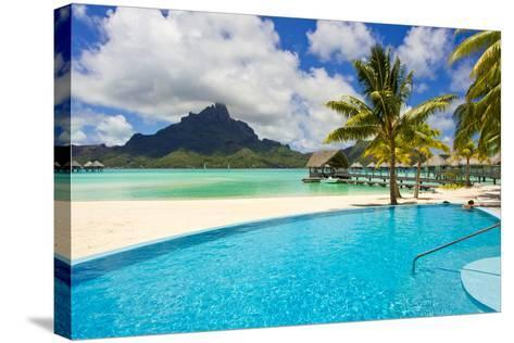 A Swimming Pool on the Beach at the Le Meridien Resort, with Mount Otemanu in the Distance-Mike Theiss-Stretched Canvas Print