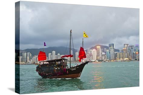 A Boat Named Aqualuna in Victoria Harbor with the Hong Kong Skyline in the Distance-Mike Theiss-Stretched Canvas Print