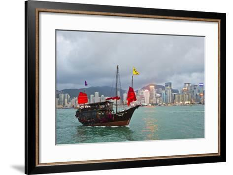 A Boat Named Aqualuna in Victoria Harbor with the Hong Kong Skyline in the Distance-Mike Theiss-Framed Art Print