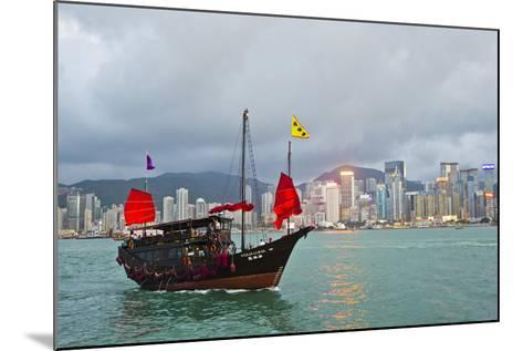 A Boat Named Aqualuna in Victoria Harbor with the Hong Kong Skyline in the Distance-Mike Theiss-Mounted Photographic Print