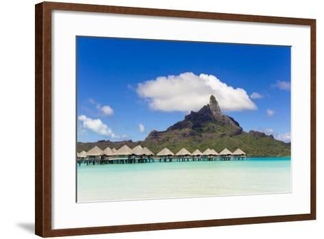 Bungalows on Stilts in a Lagoon with Mount Otemanu in the Near Distance-Mike Theiss-Framed Art Print