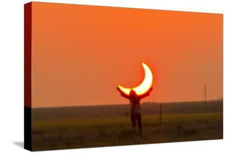 Woman Holds Up Arms as If She Is Holding Up the Annular Solar Eclipse-Mike Theiss-Stretched Canvas Print