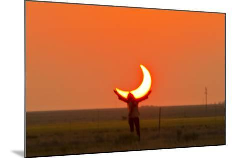 Woman Holds Up Arms as If She Is Holding Up the Annular Solar Eclipse-Mike Theiss-Mounted Photographic Print
