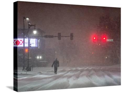 A Man Walking to Work Waits for a Red Light During a Predawn Snowstorm-Jim Reed-Stretched Canvas Print