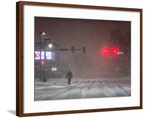 A Man Walking to Work Waits for a Red Light During a Predawn Snowstorm-Jim Reed-Framed Art Print