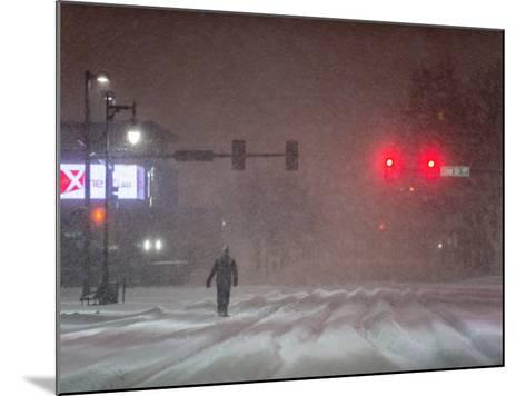 A Man Walking to Work Waits for a Red Light During a Predawn Snowstorm-Jim Reed-Mounted Photographic Print