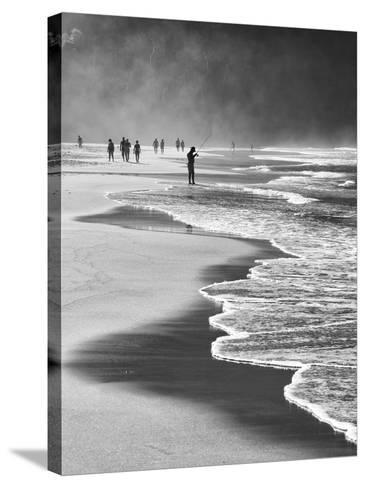 A Local Fisherman Fishing on Itamambuca Beach, Ubatuba, Brazil-Alex Saberi-Stretched Canvas Print