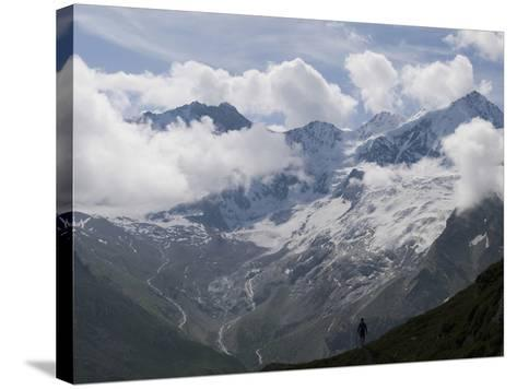 Summer Walker Silhouetted Against a Chain of Mountains-Design Pics Inc-Stretched Canvas Print