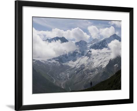 Summer Walker Silhouetted Against a Chain of Mountains-Design Pics Inc-Framed Art Print