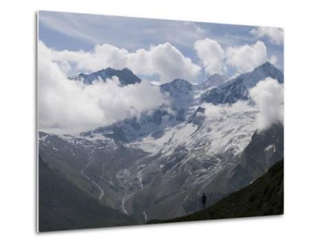Summer Walker Silhouetted Against a Chain of Mountains-Design Pics Inc-Metal Print