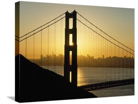 Yellow Sunrise Behind the Golden Gate Bridge with Skyline Behind-Design Pics Inc-Stretched Canvas Print