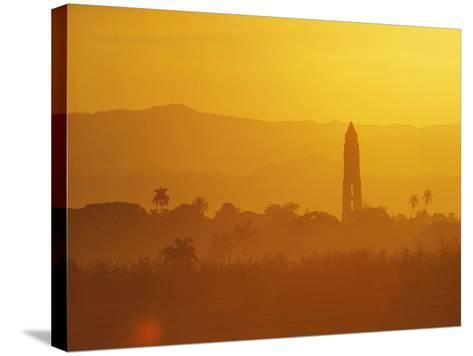 Tower Silhouetted Amongst Orange Mountains-Design Pics Inc-Stretched Canvas Print