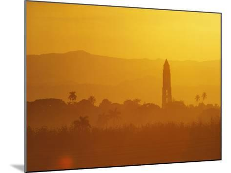 Tower Silhouetted Amongst Orange Mountains-Design Pics Inc-Mounted Photographic Print