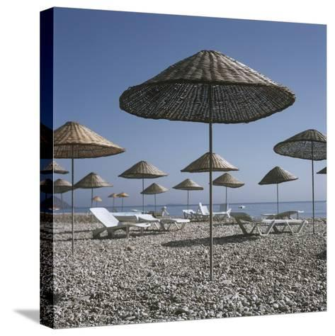 Palapas and Sun Loungers on Beach-Design Pics Inc-Stretched Canvas Print