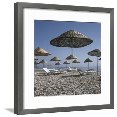 Palapas and Sun Loungers on Beach-Design Pics Inc-Framed Art Print