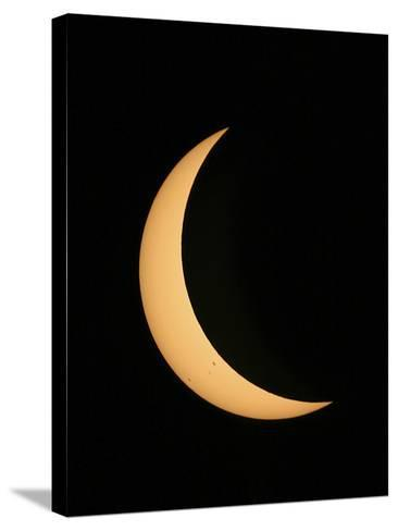 Partial Phase of a Solar Eclipse Photographed Through a Telescope-Babak Tafreshi-Stretched Canvas Print