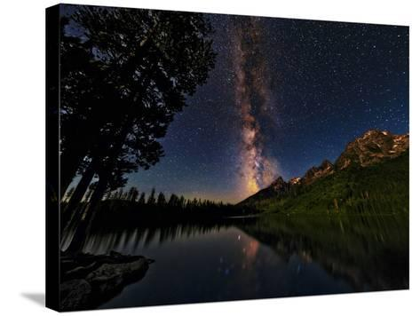 The Milky Way Shines over the Teton Range-Babak Tafreshi-Stretched Canvas Print