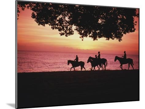 Riding Horses on the Beach at Sunset-Design Pics Inc-Mounted Photographic Print