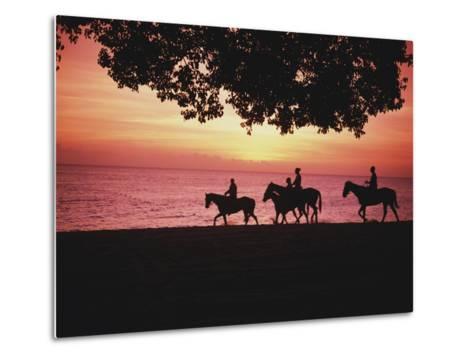 Riding Horses on the Beach at Sunset-Design Pics Inc-Metal Print