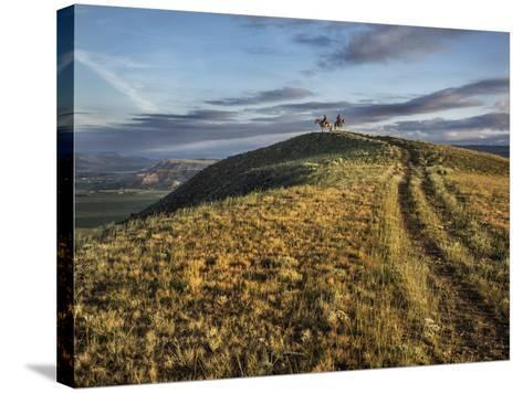 Wranglers on Horses Looking over the Dubois Badlands and Ramshorn Mountain, in Wind River Valley-Jay Dickman-Stretched Canvas Print