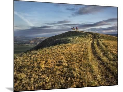 Wranglers on Horses Looking over the Dubois Badlands and Ramshorn Mountain, in Wind River Valley-Jay Dickman-Mounted Photographic Print