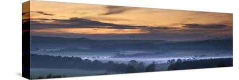 Fog Lies over a Town at Sunset; Swarland, Northumberland, England-Design Pics Inc-Stretched Canvas Print