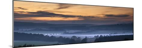 Fog Lies over a Town at Sunset; Swarland, Northumberland, England-Design Pics Inc-Mounted Photographic Print