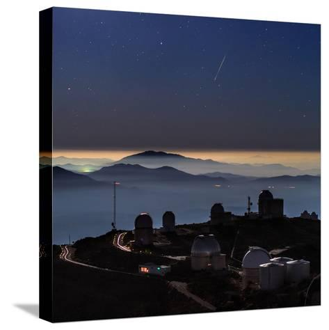 A Colorful Meteor Photographed Above Telescope Domes and Inversion Layer-Babak Tafreshi-Stretched Canvas Print