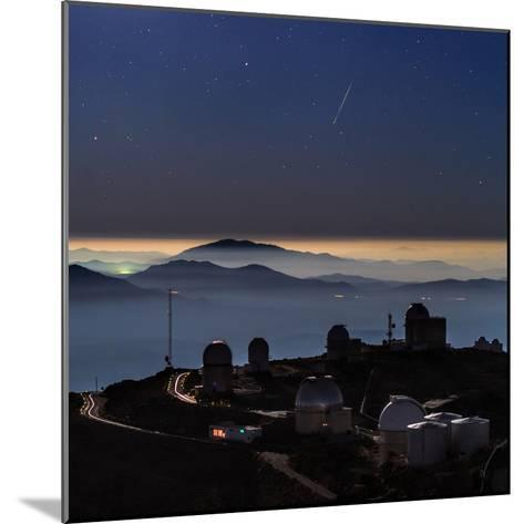 A Colorful Meteor Photographed Above Telescope Domes and Inversion Layer-Babak Tafreshi-Mounted Photographic Print