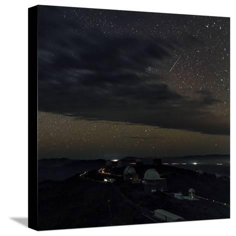 A Meteor Appears Next to the Beehive Star Cluster (M44) Above La Silla Telescope Domes-Babak Tafreshi-Stretched Canvas Print